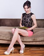 Eva Lisana slides off her pink skirt to masturbate